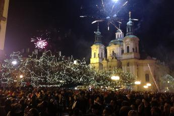Amateur fireworks shows dazzle visitors to Prague's St. Nicholas Church in Old Town Square on New Year's Eve, 2012.