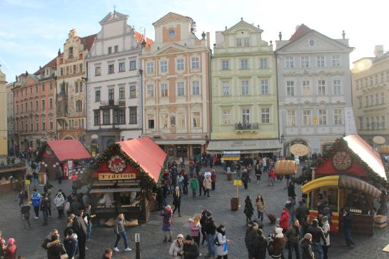 Trdelnik vendors sit in Prague's Old Town Square.