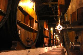 Wine ages in wooden barrels at Taylor's Port Wine in Porto, Portugal.