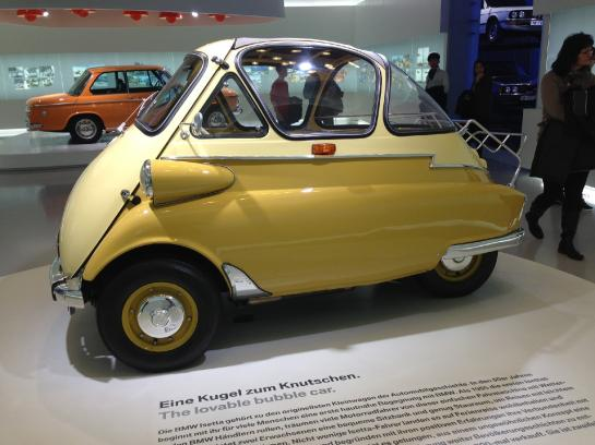 "A classic BMW Isetta, ""the lovable bubble car,"" sits in the BMW Museum in Munich, Germany."