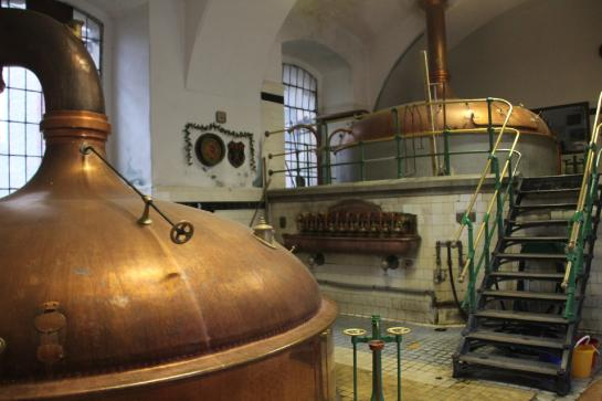 Attractive copper brew kettles sit waiting in the ancient Eggenberg Brewery in Český Krumlov.
