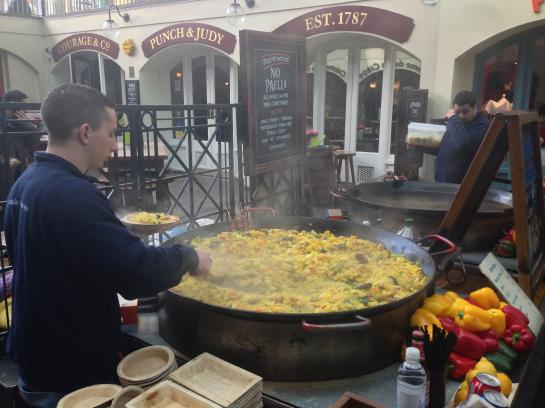 A man makes paella at Covent Garden Marker in London.