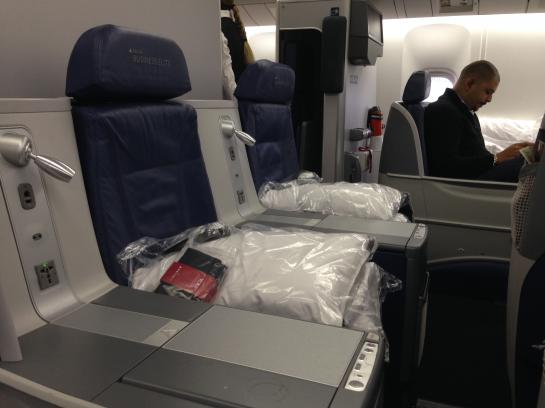 Delta's BusinessElite seats convert into lie-flat beds.