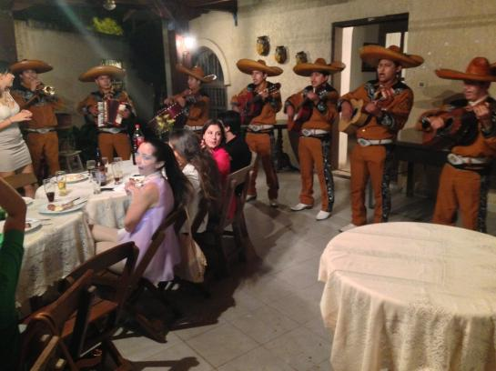 A mariachi band entertains at a Bolivian birthday party.