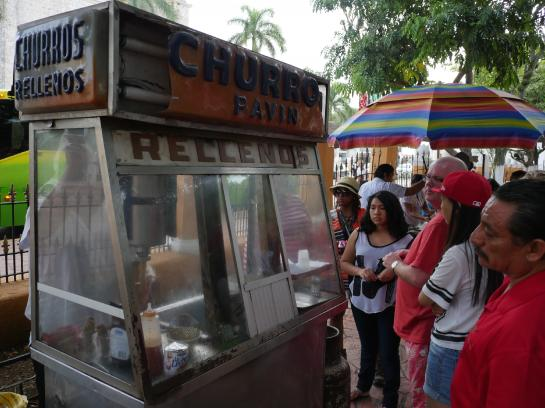 A vendor sells stuffed churros in Valladolid, Mexico.