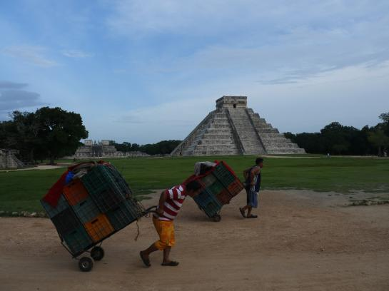 Souvenir vendors pack up their stalls at the end of the day in front of El Castillo in Chichen Itza, Mexico.
