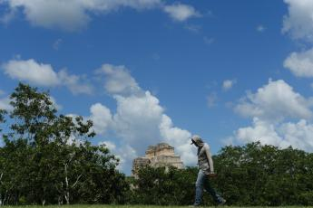 Uxmal Magician's House, clouds, construction worker