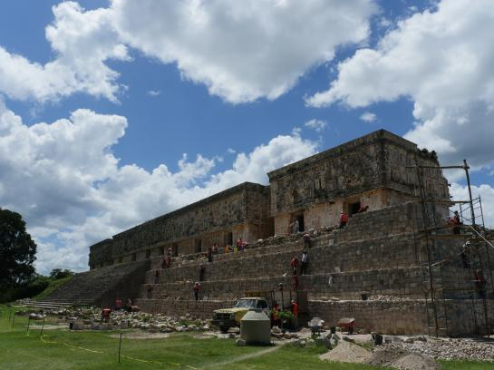 Construction workers work to restore the ruins of the Palace of the Governor in Uxmal, Mexico.