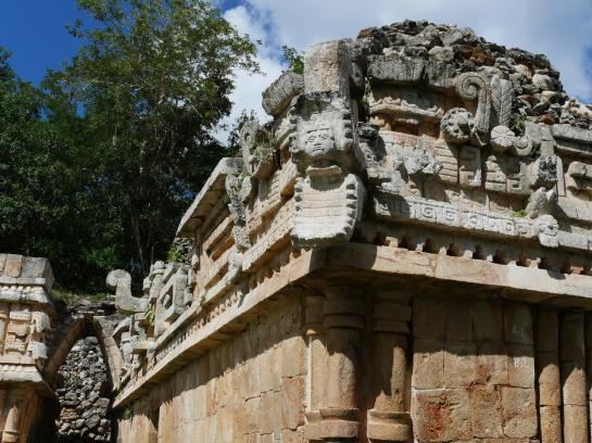 The face of the Mayan rain god Chac looks out from the Palace at Labná on the Ruta Puuc in Yucatán, Mexico.