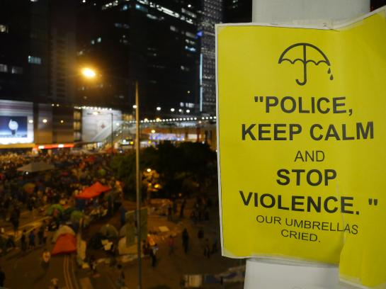 A sign pleads with the police at Occupy Central in Hong Kong.