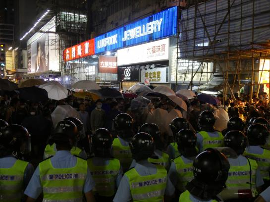 Police face off with umbrella-wielding protesters in the Mong Kok neighborhood of Hong Kong.