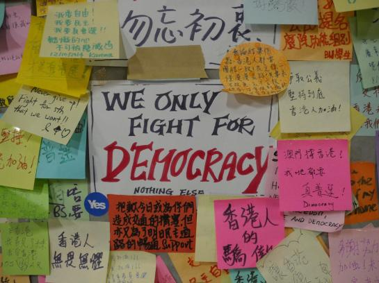 A sign on the Lennon Wall Hong Kong explains the protesters' mission.