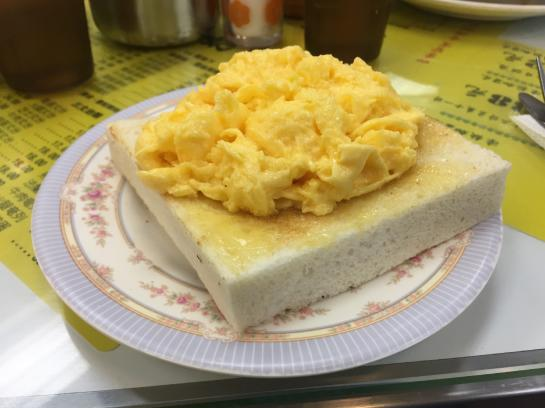 Fluffy scrambled eggs and toast are the Australia Dairy Company's signature dish.