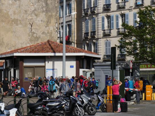Pilgrims gather for a bus departure to Saint-Jean-Pied-de-Port, France to begin hiking the famous Camino de Santiago.