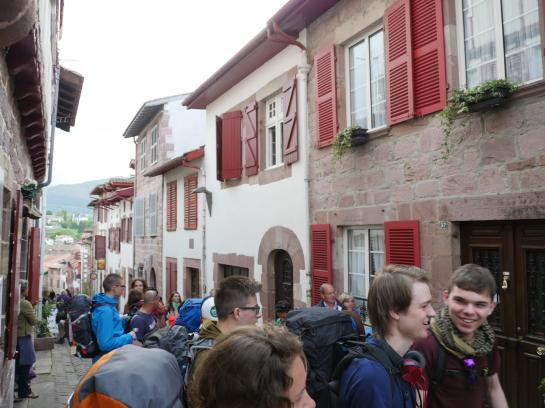 Pilgrims wait in line in Saint-Jean-Pied-de-Port, France to obtain their pilgrim's passport before beginning their trip on the Camino de Santiago.
