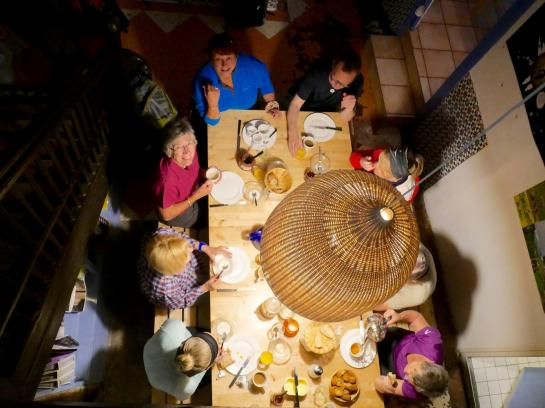 Pilgrims eat breakfast at an albergue in Saint-Jean-Pied-de-Port, France before beginning their walk on the Camino de Santiago.