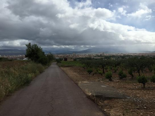 Storm clouds hover over the Camino de Santiago on the way to Puente La Reina, Spain.