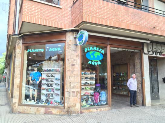 The owner of Planeta Agua stands outside the store in Logroño, Spain.