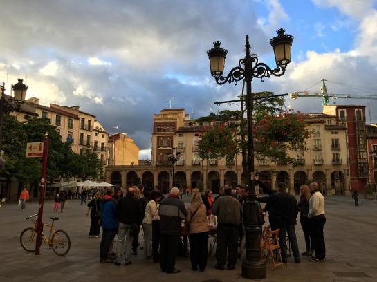 People gather in a plaza in Logroño, Spain.