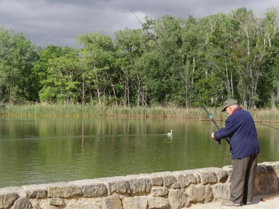 A man fishes in a lake near Logroño, Spain.