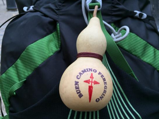 A gourd, representing those that medieval pilgrims used to carry water, sits strapped to my backpack after I received it as a gift from the owner of the sports store Planeta Agua in Logroño, Spain.