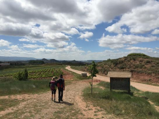 Hannah and Arnaud walk hand-in-hand on the way to Nájera, Spain on the Camino de Santiago.