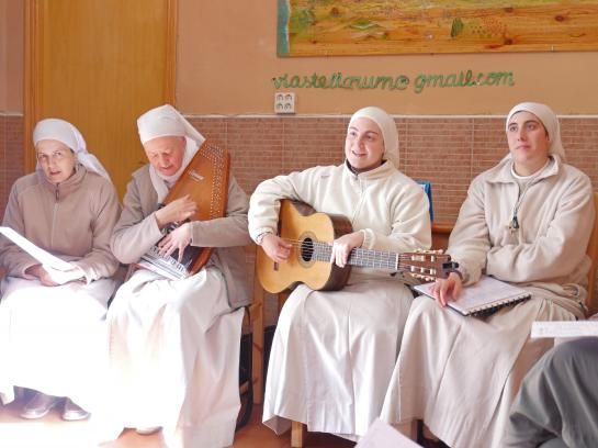 Four nuns sing in the entrance hall of the albergue in Carrión de los Condes, Spain.