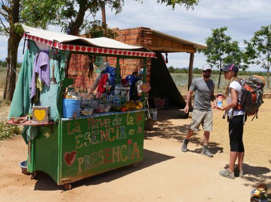 Volunteers give pilgrims free food and juice on a hill in Villares de Órbigo above Astorga, Spain.