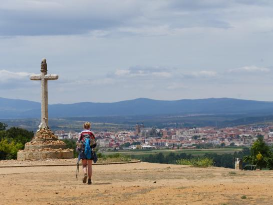 A Camino pilgrim walks toward Crucero de Santo Toribio above Astorga, Spain.