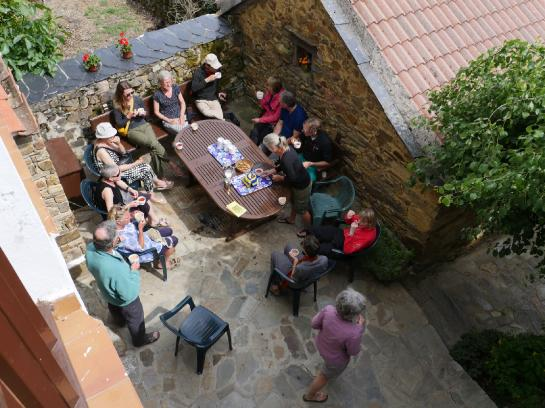 Pilgrims gather for tea in the Guacelmo albergue in Rabanal del Camino, Spain.