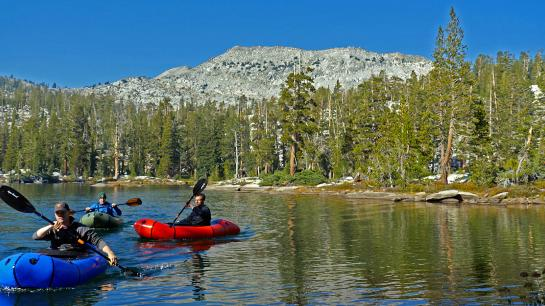 Rich, Hank, and Jake paddle packrafts around Rainbow Lake in Ansel Adams Wilderness.