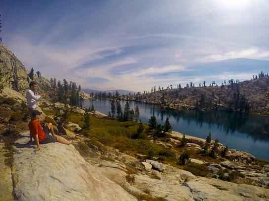 Hikers look out at Chittenden Lake in Ansel Adams Wilderness.