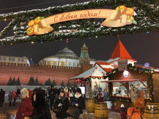 Snow falls over a Christmas market in Moscow's Red Square.