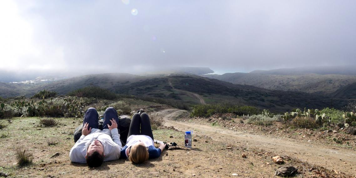 Hikers stop for a quick nap on the Trans-Catalina Trail on California's Catalina Island.