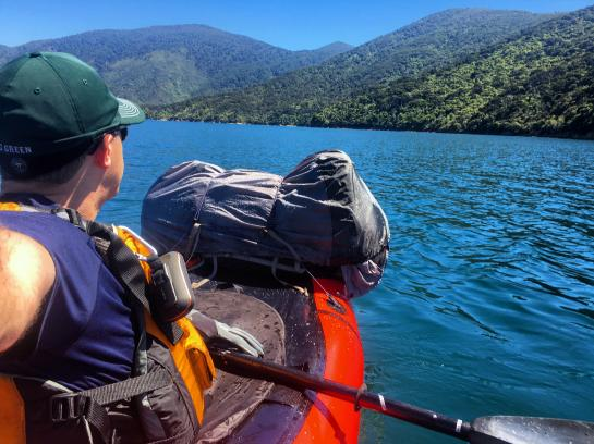 A paddler admires Queen Charlotte Sound, New Zealand from a packraft.