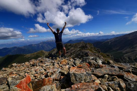 Hank celebrates his arrival atop Mount Rintoul in New Zealand's Richmond Range.