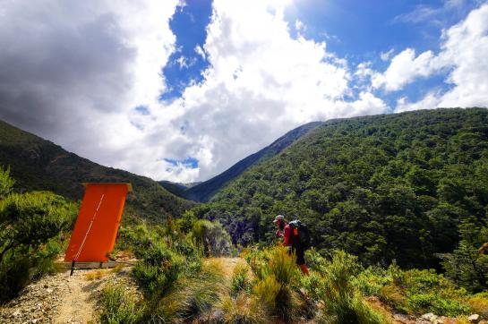 An outhouse sits in the Red Hills in New Zealand's Richmond Range.