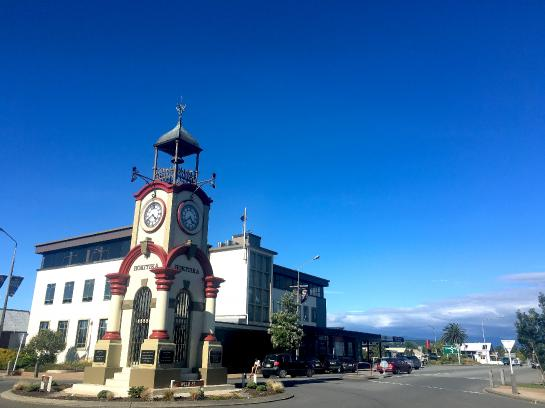 An iconic clocktower sits in the middle of Hokitika, New Zealand.