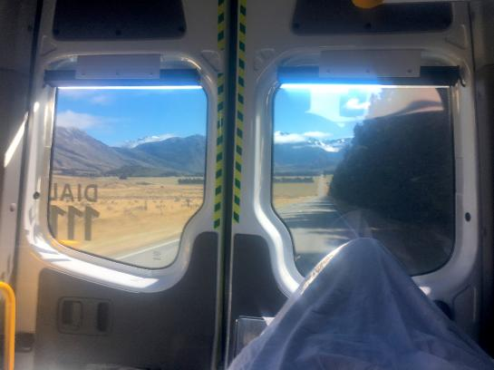 The view of New Zealand's Lewis Pass Road from the back of an ambulance is dazzling.