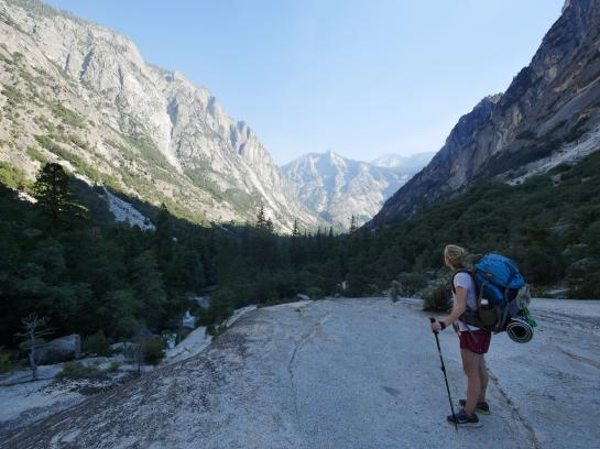 A hiker looks at a view of mountains in Paradise Valley, Kings Canyon National Park, California.