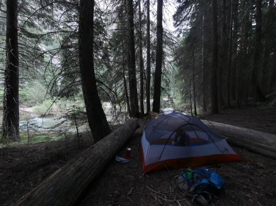 A tent sits near the Kings River in Kings Canyon National Park, California.