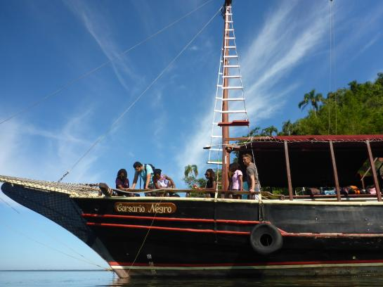 The kids and scientists explore the ocean on a boat docked at IIlha de Jaguanum, of the coast of Rio de Janeiro, Brazil.