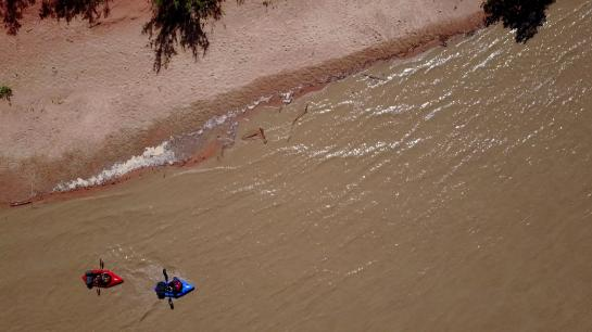 Packrafters paddle down the San Juan River.