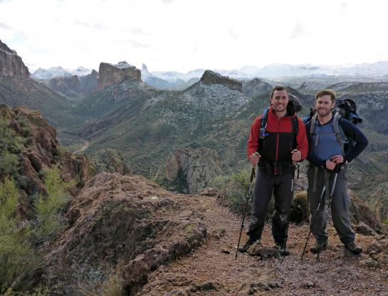 Hank and Brian stand in Arizona's Superstition Mountains on the Boulder Canyon Trail.
